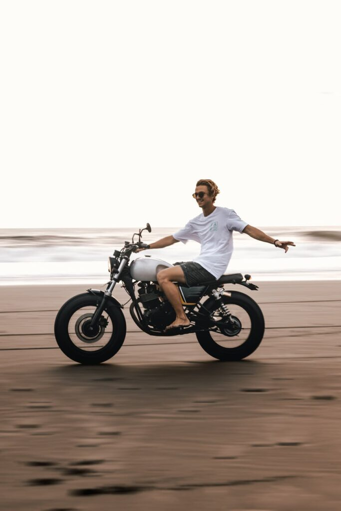 photo of man riding bicycle